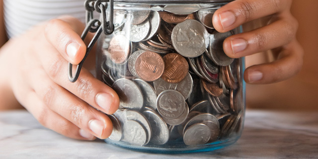 Jar full of foreign currency coins